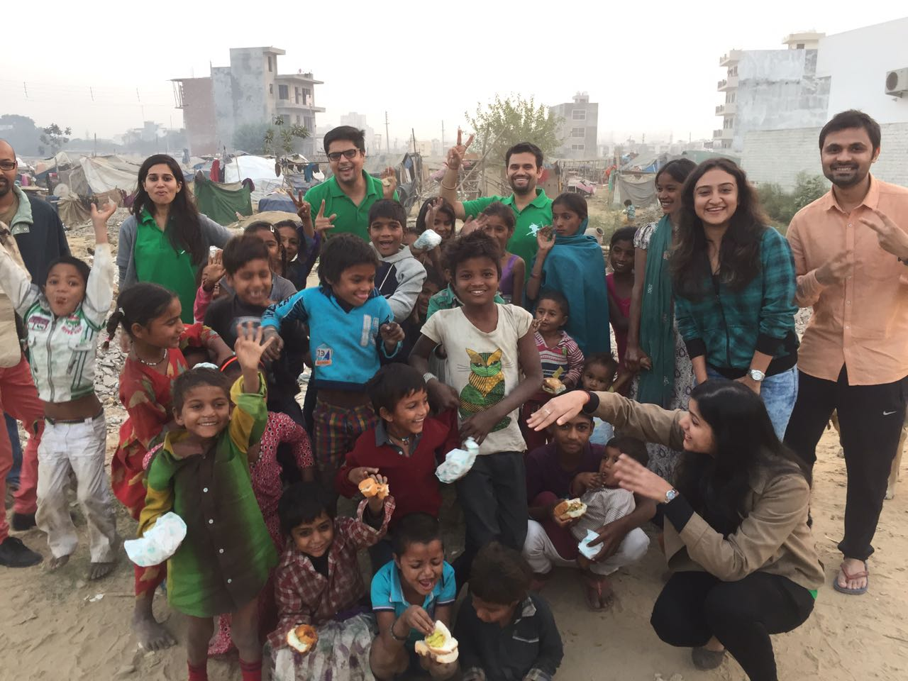 The children flanked by the volunteers who feed them every week