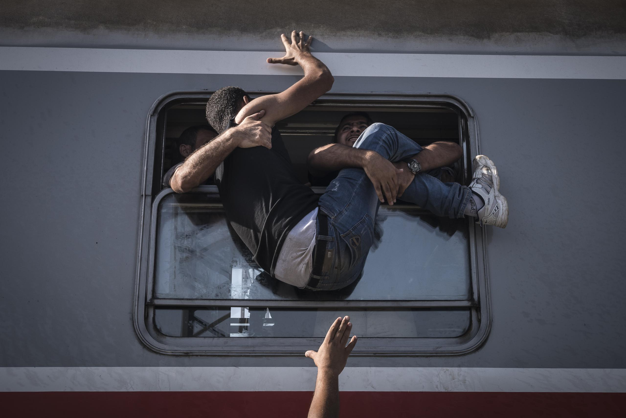 Sergey Ponomarev won the first prize for his story on the refugee crisis for the New York times in the General News category.  In this particular picture, a man struggles to board a train headed to the Croatian capital Zagreb, in Tovarnik, a town near the border with Serbia.